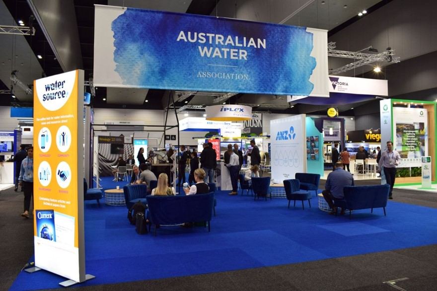Photo of Ozwater 2019 event with huge banners and people sitting and standing